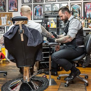 Tattooist using Bambach saddle seat